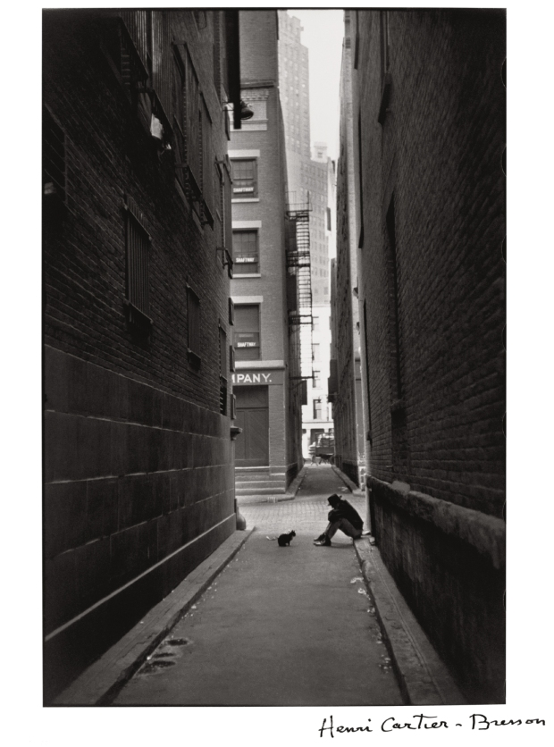 Henri Cartier-Bresson, Man in the street with his dog, New York, 1932